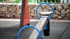 Empty swings in a playground. Stock Footage