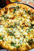 Chicken pine nut pizza Stock Photos