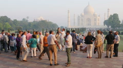 Western tour groups on a visit to the Taj Mahal Stock Footage