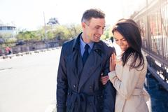 Smiling couple walking outdoors - stock photo
