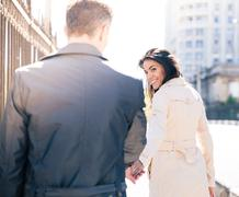 Happy couple walking outdoors Stock Photos