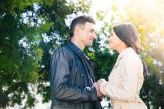 Happy couple on a date outdoors Stock Photos
