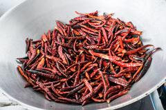 Chilli dry in the pan Stock Photos