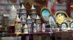 Souvenirs behind glass in storefront - tourists carry them home from Vienna Stock Footage