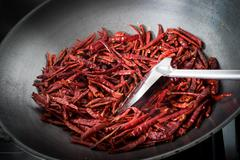 Chilli dry in the pan - stock photo
