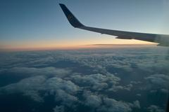 Aircraft Wings in the Sky - Overhead - Blue Sky - Clouds - Lufthansa 2 Stock Photos