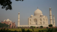 The Taj Mahal is caught in a frame of trees and plants Stock Footage