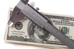 Calliper and Dolars - stock photo