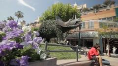 Dinosaur fountain on third street promenade wider Stock Footage