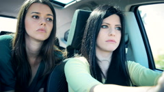 Serious women discussing in car driving closeup Stock Footage