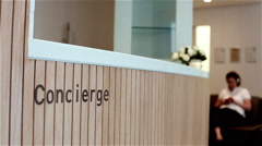 Concierge desk with waiting room in distance Stock Footage