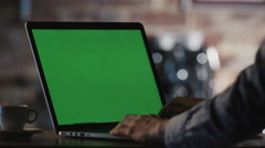 Man using Laptop with Green Screen in Cafe - stock footage