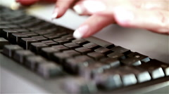 Manicured nails typing on computer keyboard Stock Footage