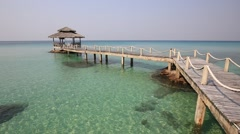 Wooden pier and sea water on beautiful tropical beach.Island Koh Kood , Thailand Stock Footage