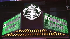 Starbucks Coffee flshing sign in NYC Stock Footage