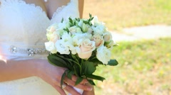 Young bride with wedding bouquet of flowers in her hands. Wedding decor. Stock Footage