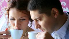 Bride and groom talking, kissing, smiling, having rest in cafeteria Stock Footage
