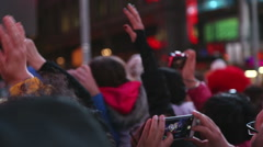 Fans with cellphones taking pictures - stock footage