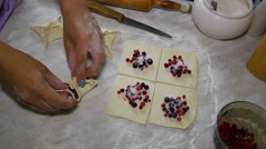 Bake the cake of puff pastry with berries cranberries and blueberries Stock Footage