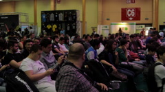 Room Full Of People At Convention, Crowd, Side Shot, Comicon Stock Footage