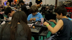 Kids Painting Figurines At Convention, Pan, Comicon Stock Footage