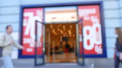 Clothing store and street going people Blurred scene .4K ( 3840x2160)  Stock Footage