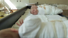 Infants lying on the table at maternity ward and one newborn hungry baby crying. - stock footage