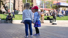 Small children  dance with street musicians.4K ( 3840x2160) - stock footage