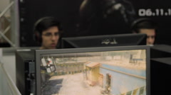 Gaming Tournament At Convention, Teenagers Playing, Game on Screen, Rack Focus Stock Footage