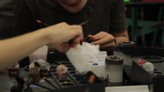 Young Man Painting Figurine, Contest, Convention, Comicon Stock Footage