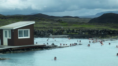 People Swim at the MYVATN NATURE BATHS, ICELAND - CIRCA AUGUST, 2014 Stock Footage