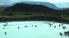 People Swim at the MYVATN NATURE BATHS, ICELAND - CIRCA AUGUST, 2014 Stock Footage