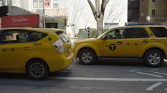 taxi cabs in street, tracking shot from sidewalk, slow motion, 4K Manhattan NYC - stock footage