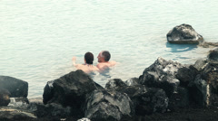 A Couple at the MYVATN NATURE BATHS, ICELAND - CIRCA AUGUST, 2014 Stock Footage