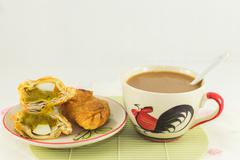 Curry immediately, Thailand snacks are delicious served with coffee. Stock Photos