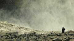 Tourist at DETTIFOSS WATERFALL, ICELAND - CIRCA AUGUST, 2014 Stock Footage