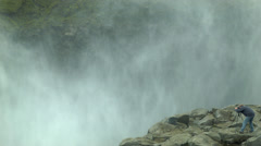 Photographer at DETTIFOSS WATERFALL,ICELAND - CIRCA AUGUST, 2014 Stock Footage
