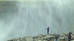 Tourists at Dettifoss Waterfall ICELAND - CIRCA AUGUST, 2014 Stock Footage