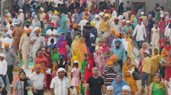 Religion in India, colorful crowds visit Sikh Golden Temple Stock Footage