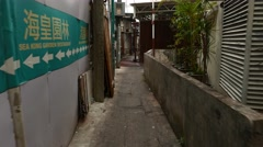 Walk through narrow gangway between hovel to sea view, Stock Footage