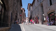 Tourists walking in Assisi Italy Stock Footage