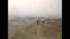 Vintage 16mm film, Peru archaeological site desert with small group, 1960 - stock footage