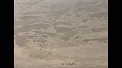 Vintage 16mm film, Peru archaeological site desert pan, 1960 Stock Footage