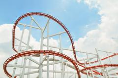 Colorful roller coaster over blue sky - stock photo