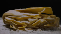 PASTA GETS A DUSTING OF FLOUR. Stock Footage