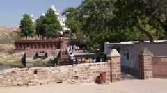 People walking down the street that leads to Jaswant Thada temple. Stock Footage