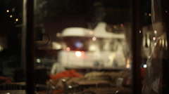 Boat in Jaffa port at night, long shot, shallow focus Stock Footage