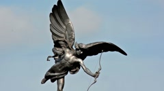 Eros statue closeup in Piccadilly Circus with walkers silouette Stock Footage