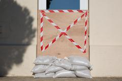 Bag of cement to prevent the door to enter the house Stock Photos