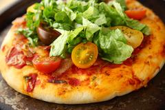 Pizza with bacon, lettuce and fresh tomatoes Stock Photos